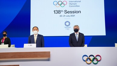 IOC President Thomas Bach with the Prime Minister of Japan SUGA Yoshihide