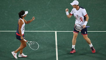 Andy Murray of Great Britain (R) and Heather Watson of Great Britain celebrate victory