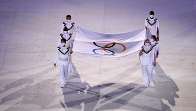 The flag bearers of the Olympic flag