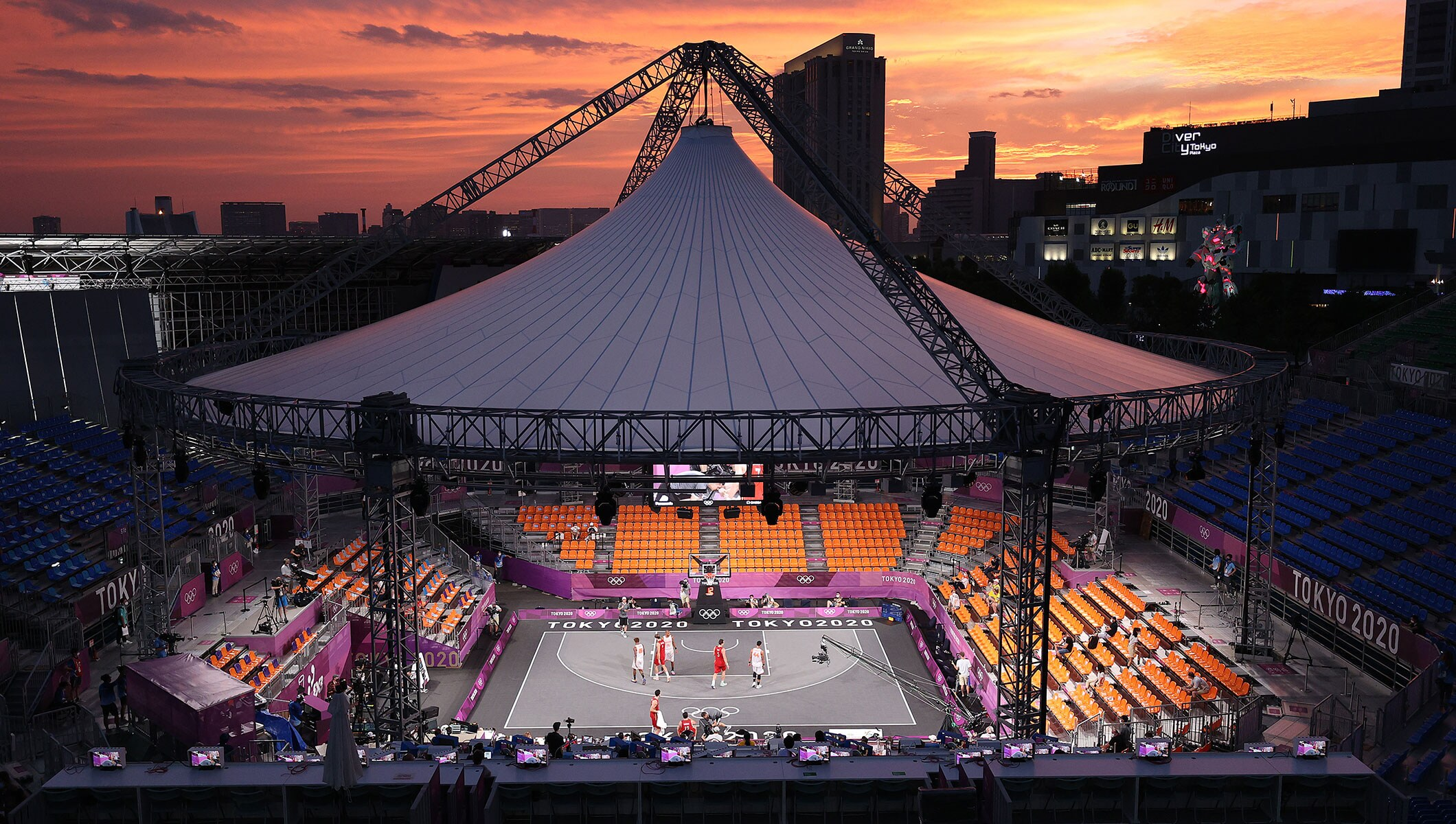 A general view of play at sunset in the 3x3 Basketball competition on day three of the Tokyo 2020 Olympic Games