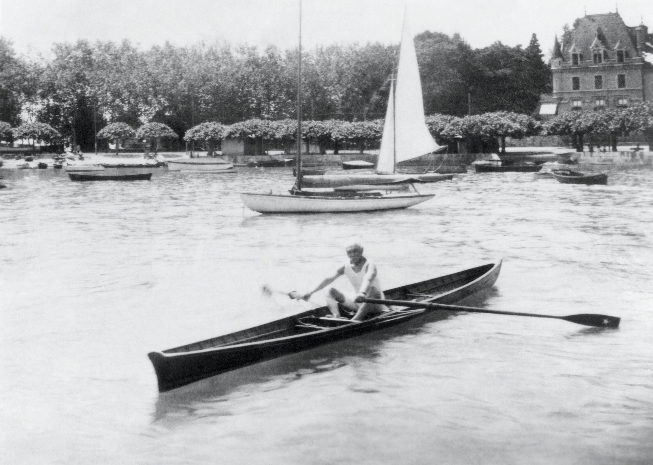 Baron Pierre de COUBERTIN rowing in Ouchy harbour.
