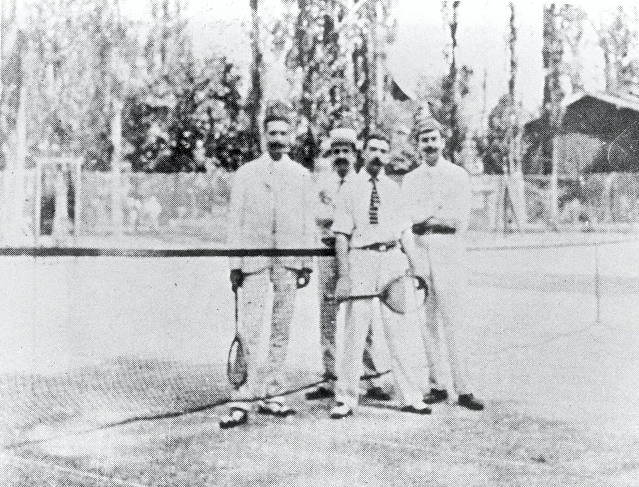 Baron Pierre de COUBERTIN on a tennis court.
