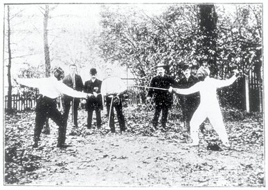 Baron Pierre de COUBERTIN against Mr. VIENNE at the School of Utilitarian Sports. Pr DUBOIS in the middle.
